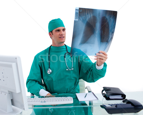 Encantador cirurgião olhando raio x branco trabalhar Foto stock © wavebreak_media