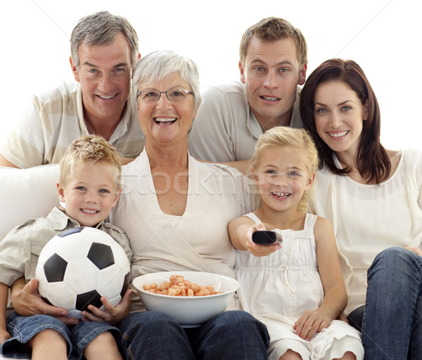 Happy family watching a football match at home Stock photo © wavebreak_media
