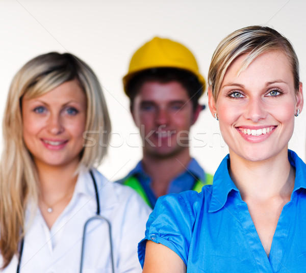 Doctor, businesswoman and architect smiling at the camera Stock photo © wavebreak_media