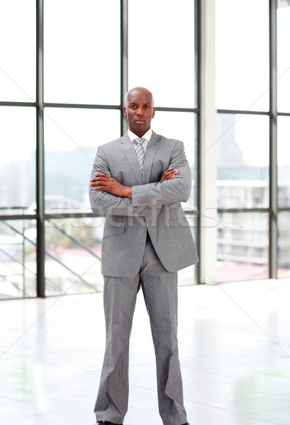 Serious businessman with folded arms  Stock photo © wavebreak_media