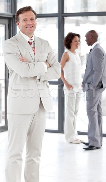 Portrait of a self-assured businessman with his team Stock photo © wavebreak_media