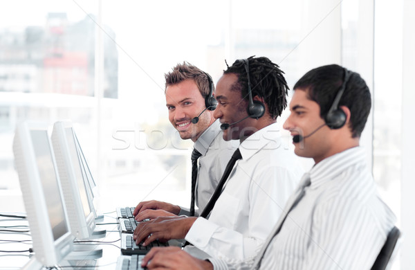 International business team in a call center wearing headsets Stock photo © wavebreak_media