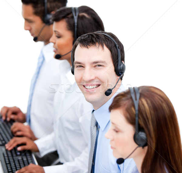 Portrait of smiling businessteam with an headset Stock photo © wavebreak_media
