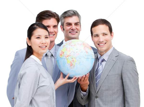 Portrait of a multi-ethnic businessteam holding a globe  Stock photo © wavebreak_media