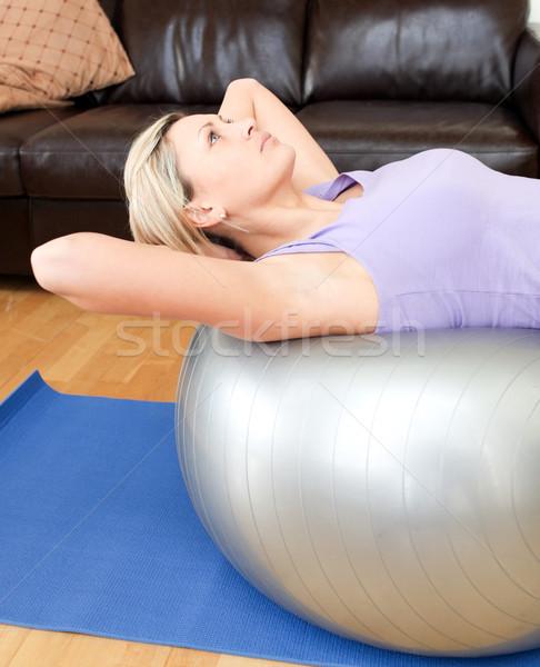 Relaxed woman doing exercice  Stock photo © wavebreak_media
