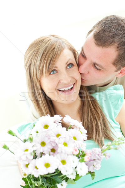 Attentive man giving a bunch of flowers to his girlfriend Stock photo © wavebreak_media