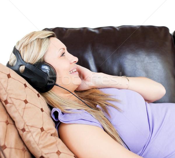 Donna cuffie divano felice rock Foto d'archivio © wavebreak_media