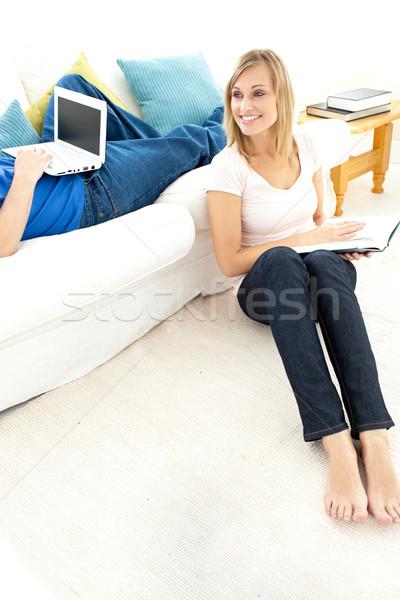 Smiling couple having free time in the living-room  Stock photo © wavebreak_media