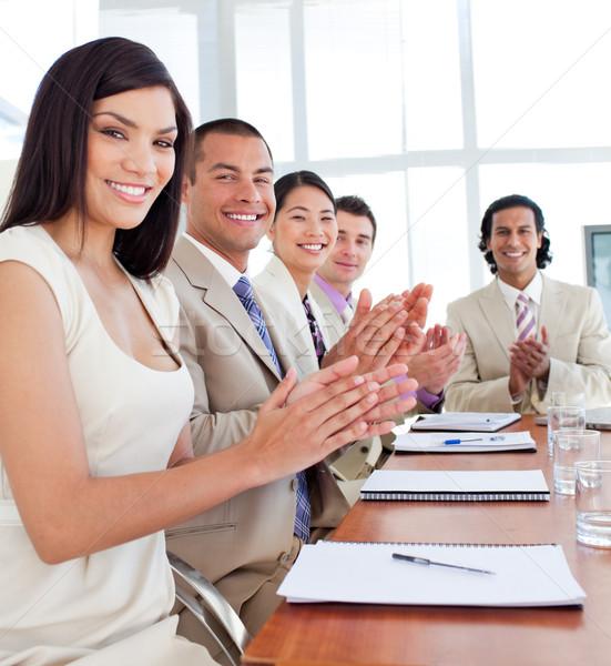 Több nemzetiségű üzleti csapat tapsol konferencia cég nő Stock fotó © wavebreak_media