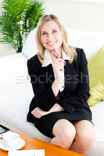 Pensive femme d'affaires verres séance canapé Photo stock © wavebreak_media