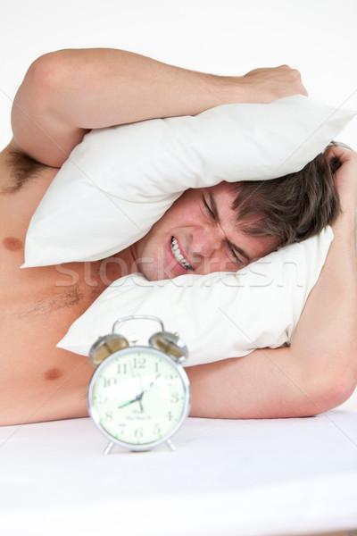 Mérges férfi felfelé ébresztőóra párna fej Stock fotó © wavebreak_media