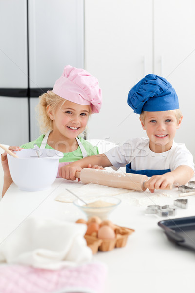 Cute sibling baking cookies together in the kicthen at home Stock photo © wavebreak_media