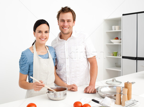 Portrait of a happy couple preparing a bolognese sauce together in the kitchen Stock photo © wavebreak_media