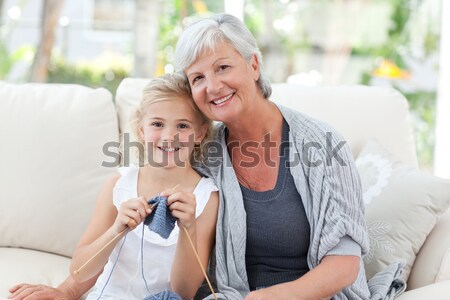 Lovely little girl with her grandmother looking at the camera Stock photo © wavebreak_media