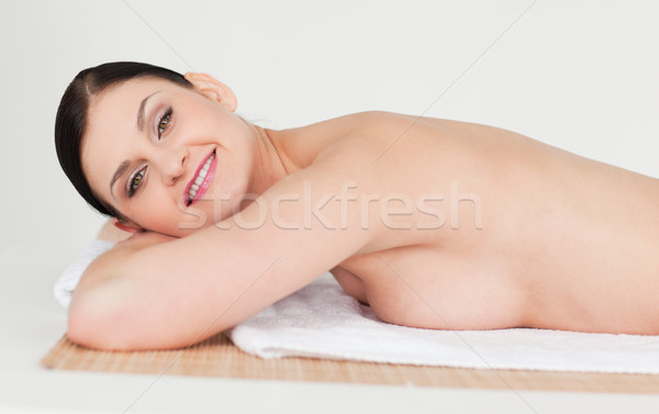 Beautiful dark-haired woman relaxing in a spa centre Stock photo © wavebreak_media