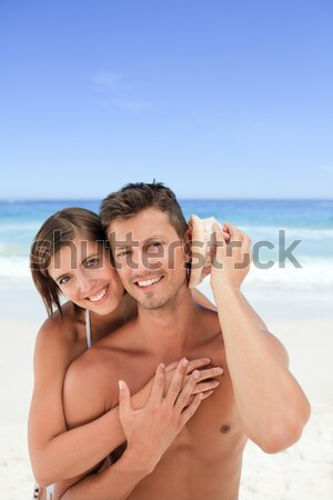 Collage of a lovely couple eating some ice creams on a beach Stock photo © wavebreak_media