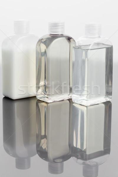 Glass phials on a mirror Stock photo © wavebreak_media