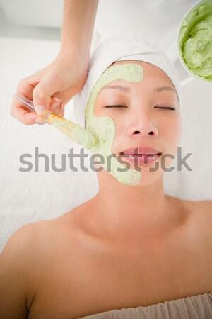 Portrait of a smiling woman having massage oil versed on her back Stock photo © wavebreak_media