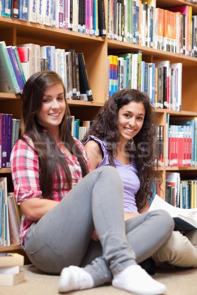 Portrait of female students holding a book Stock photo © wavebreak_media