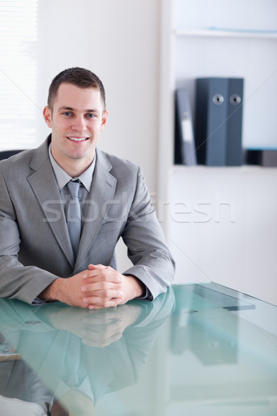 Close up of businessman sitting behind a table Stock photo © wavebreak_media