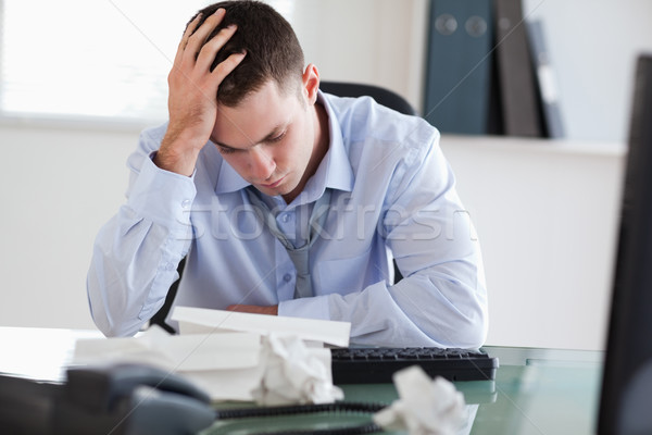 Close up of businessman getting frustrated with paperwork Stock photo © wavebreak_media
