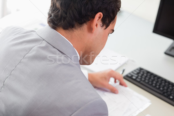 Above view of young businessman doing paper work Stock photo © wavebreak_media