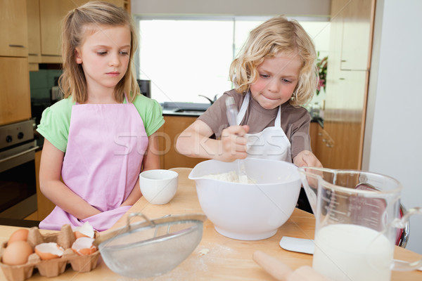 Young siblings preparing dough together Stock photo © wavebreak_media