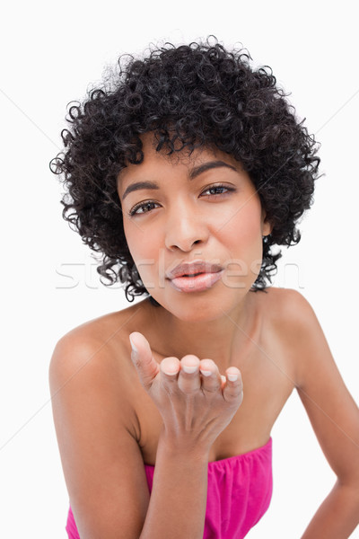 Beautiful short-haired woman placing her hand to send a kiss Stock photo © wavebreak_media