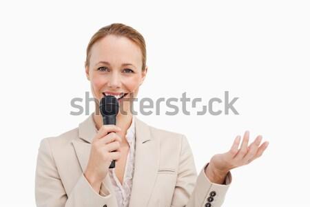 красивая женщина костюм микрофона белый счастливым Сток-фото © wavebreak_media