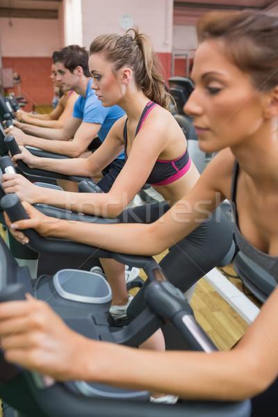 Cztery osoby wykonywania rowery siłowni kobieta sportu Zdjęcia stock © wavebreak_media