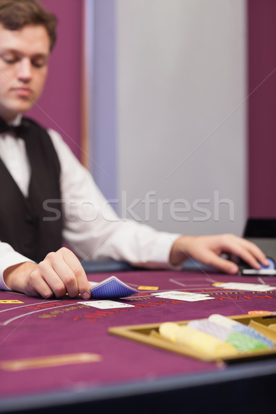 Dealer stacking cards at table of a casino while concentrating Stock photo © wavebreak_media