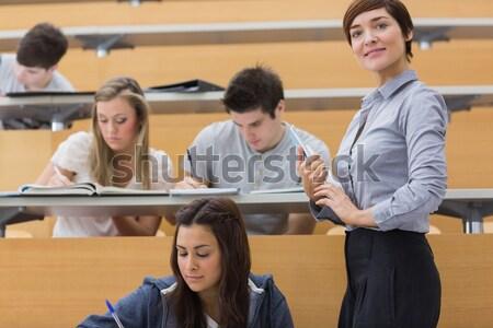 женщину сидят лекция зале стороны вверх Сток-фото © wavebreak_media