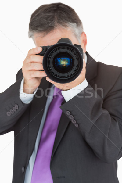Businessman using digital camera with large lens Stock photo © wavebreak_media