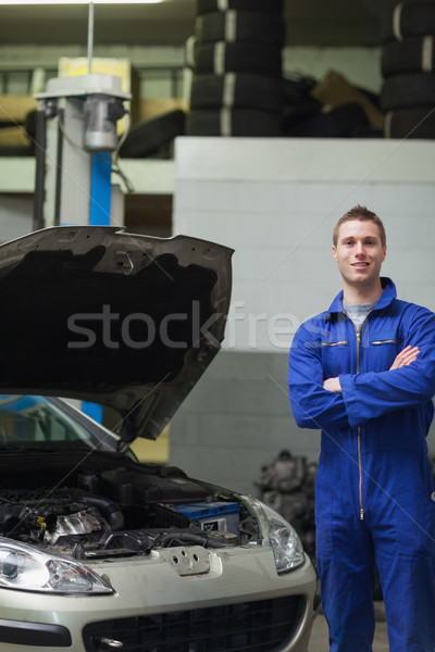 Happy mechanic standing by car with open hood Stock photo © wavebreak_media