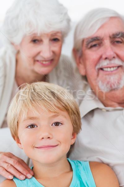 Wnuk dziadkowie uśmiechnięty posiedzenia domu miłości Zdjęcia stock © wavebreak_media