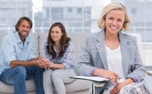 улыбаясь пару терапевт глядя камеры женщину Сток-фото © wavebreak_media