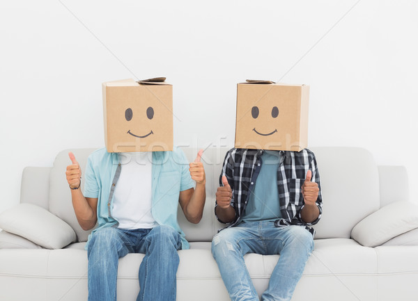 Men with happy smiley boxes over faces gesturing thumbs up Stock photo © wavebreak_media