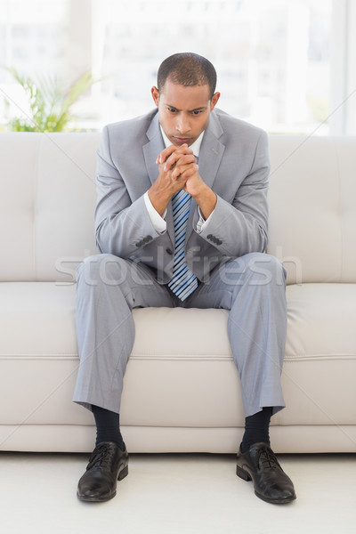 Anxious businessman sitting on couch Stock photo © wavebreak_media