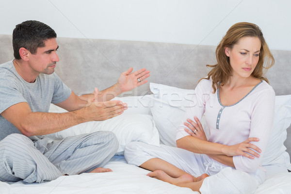 Stock photo: Couple fighting in bedroom