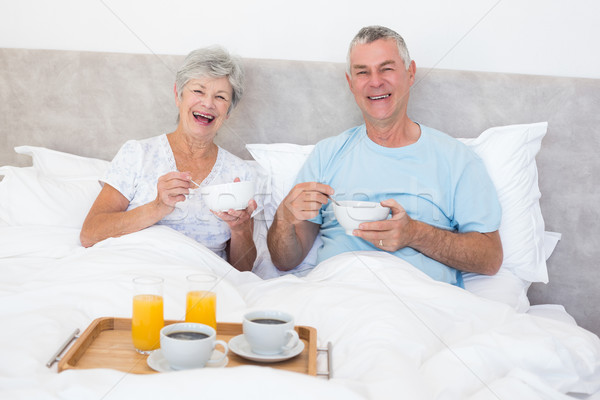 Happy senior couple having breakfast in bed Stock photo © wavebreak_media