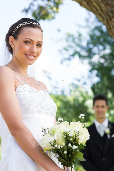 Bride holding flower bouquet in garden Stock photo © wavebreak_media