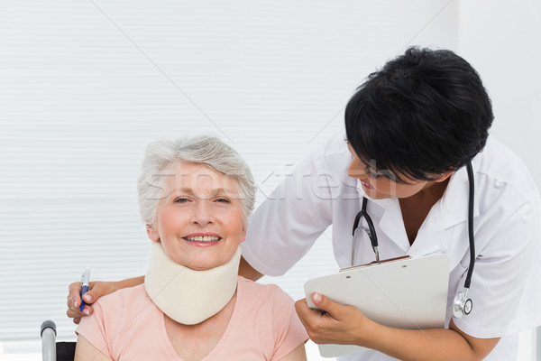 Doctor talking to a senior patient with cervical collar Stock photo © wavebreak_media