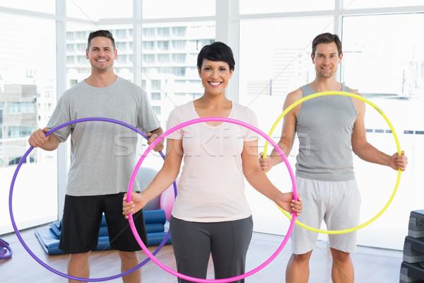 Fitness class holding hula hoops in gym Stock photo © wavebreak_media
