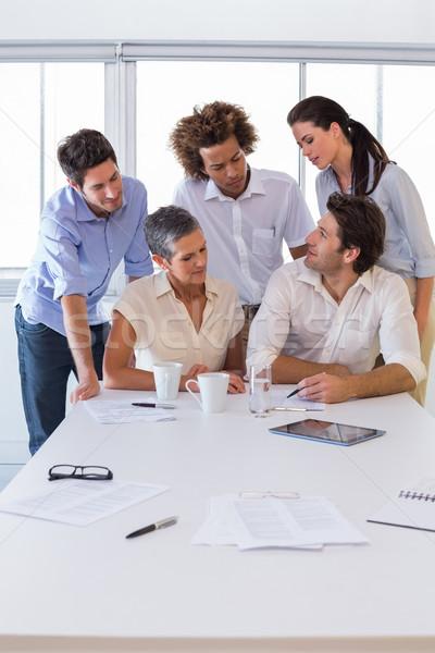 Vonzó csoport üzletemberek együtt dolgozni munkahely nő Stock fotó © wavebreak_media