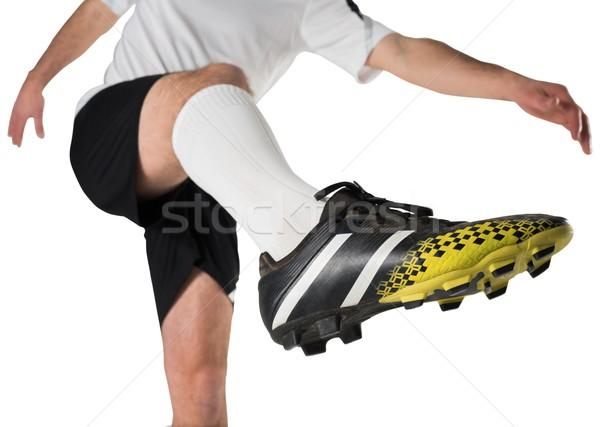Football player in white kicking Stock photo © wavebreak_media