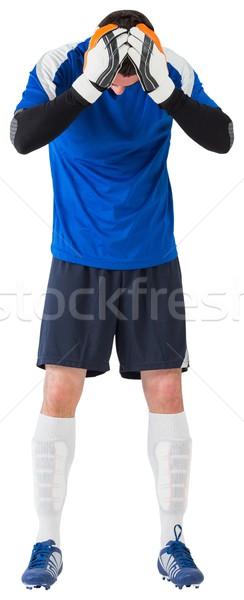 Teleurgesteld voetballer naar beneden te kijken witte voetbal voetbal Stockfoto © wavebreak_media