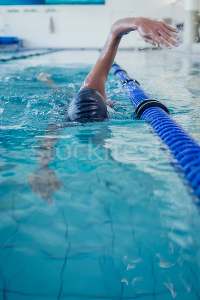 Fit swimmer doing the front stroke in the swimming pool Stock photo © wavebreak_media