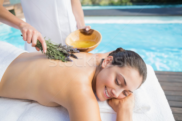 Smiling woman getting an aromatherapy treatment poolside Stock photo © wavebreak_media