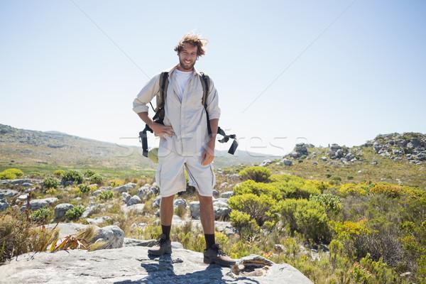 турист Постоянный улыбаясь камеры счастливым Сток-фото © wavebreak_media
