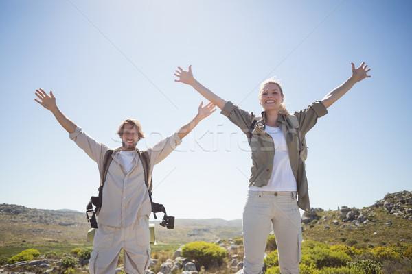 Kirándulás pár áll hegy terep mosolyog Stock fotó © wavebreak_media